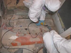 Destructive Testing (DT) taking shower apart to determine where leak occurred.