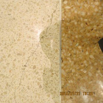 Crack in Terrazzo near divider strip.